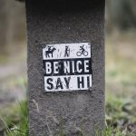 Be Nice Say Hi Sign on the trail